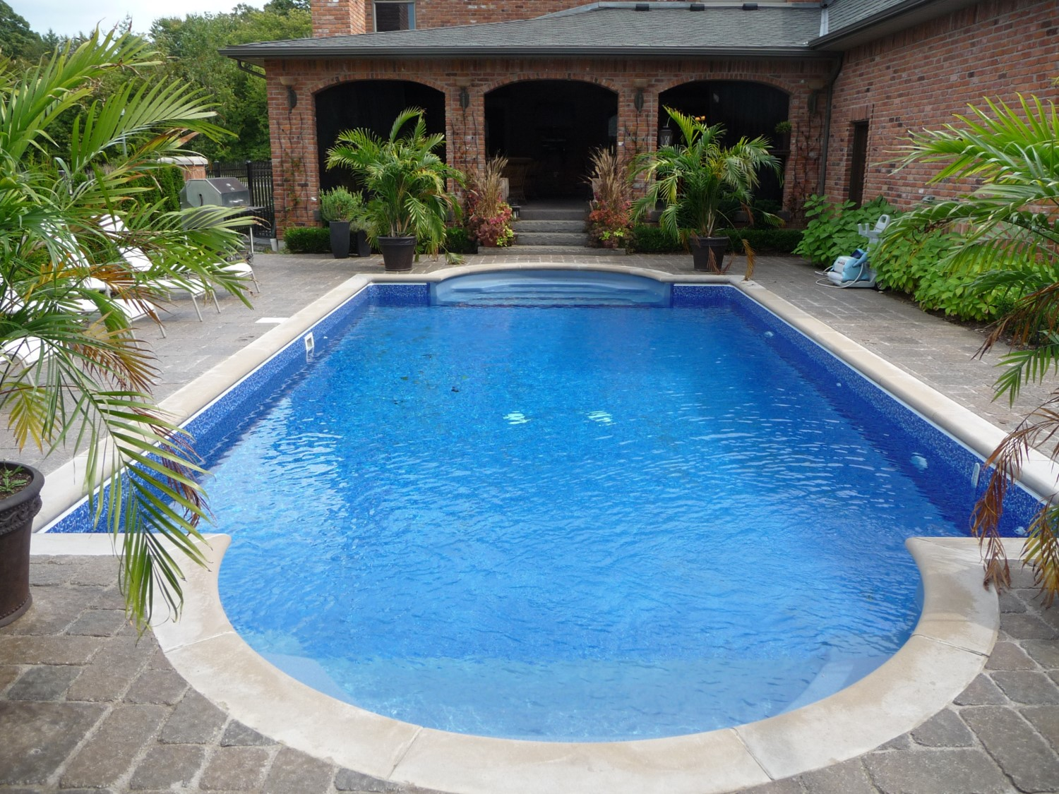 Creative homescapes pool waterfall for Pool design hours