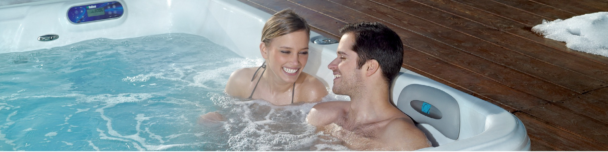 Couple enjoying a hot tub together.