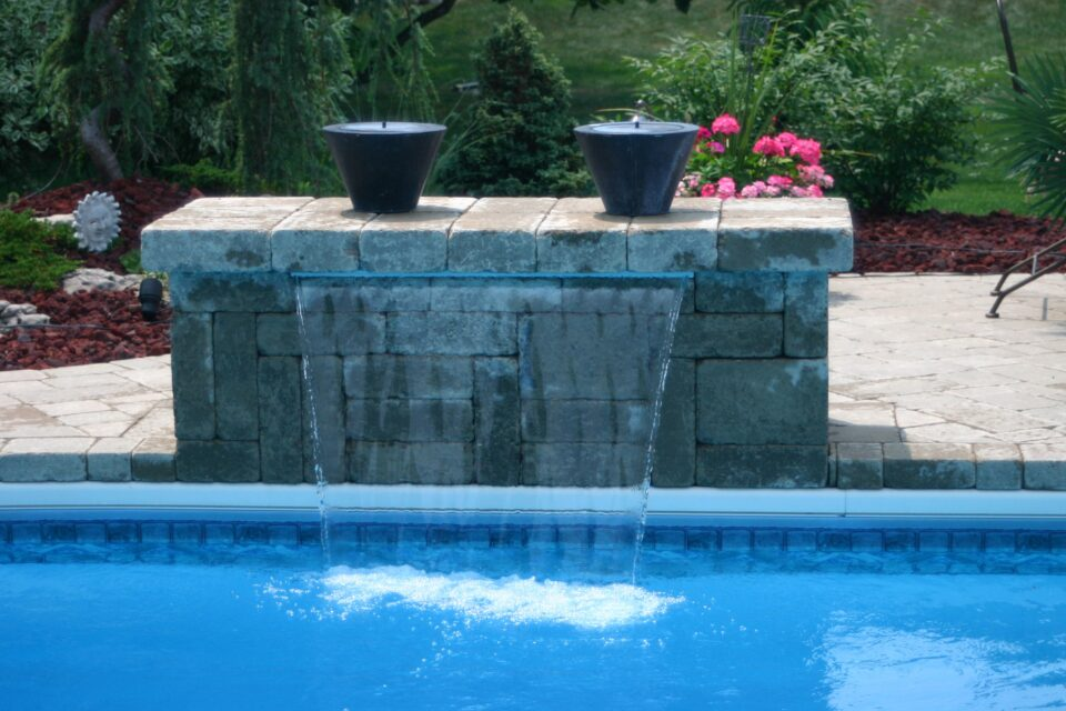 Beautiful stone waterfall cascading into the pool.